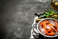White wine with shrimp and ice. On a stone background Royalty Free Stock Photo