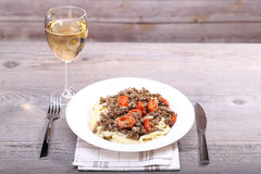 White wine and spaghetti with meat Royalty Free Stock Images
