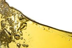 White wine splash background closeup, macro isolated on top, wave of wine, splashing, bubbles, texture, fizz. Stock Photo