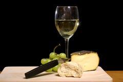 White wine still. Still life of white wine, cheese and bread Stock Photo