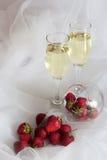 White wine and strawberries Stock Photos