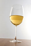 White wine in a tall stemmed glass Stock Photo