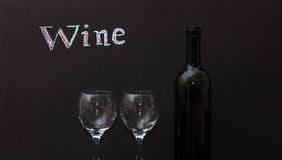 White wine and two glasses Stock Images
