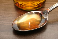 White wine vinegar. Closeup of metal spoon with vinegar stock images
