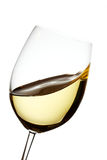 White wine waves. White wine wave in a crystal glass Stock Photo