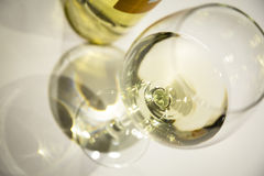 White wine on a wineglass Stock Image