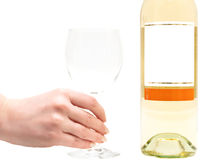 White wine with wineglass in hand Royalty Free Stock Photos