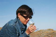 The white wine and the woman. Woman smelling withe wine outside Royalty Free Stock Image