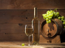 White wine on wooden background Royalty Free Stock Photo