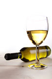 White wine on wooden table Stock Images