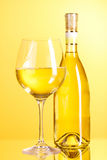 White wine on yellow Stock Image