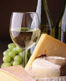 White wineglass and cheese Stock Image