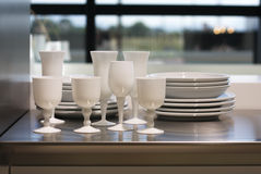 White wineglasses and plates. Royalty Free Stock Photo