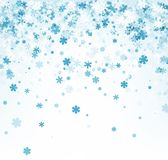 White winter background with blue snowflakes. Stock Images