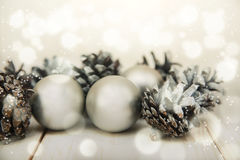 White winter cones on the wooden table with silver balls.Christmas composition royalty free stock photos