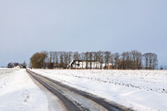 White winter landscape of field with farm Stock Images