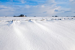 White winter landscape of field with farm Royalty Free Stock Images