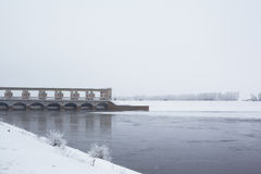 White winter tree,river and dam Stock Photo