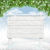 White winter wooden signboard in snow Royalty Free Stock Photo