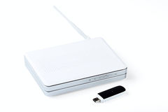 White wireless router and usb modem Royalty Free Stock Images