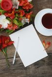 White Wmpty Blank Paper Beautiful Alstroemeria Flowers Rustic wooden Table Stock Photography