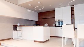 White and woden kitchen in modern style. White and woden kitchen in modern style Stock Image