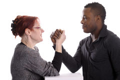 White woman and black man doing arm wrestling Stock Photography