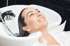 White woman getting a hair wash in a beauty salon Stock Image