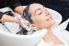 White woman getting a hair wash in a beauty salon Stock Photo