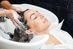 White woman getting a hair wash in a beauty salon Royalty Free Stock Images