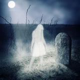 White woman ghost stay on her grave. On old cemetery royalty free stock photo