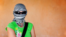 White woman in keffiyeh and sunglasses before safar