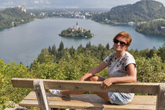White woman and lake Bled view from above in Slovenia Stock Photos