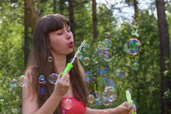 White woman make bubble blower outdoors Royalty Free Stock Photography
