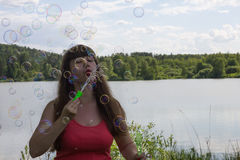 White woman make bubble blower outdoors Stock Image