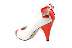 White woman shoe with red heel and bow Royalty Free Stock Image