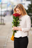 White woman smiling roses Stock Image