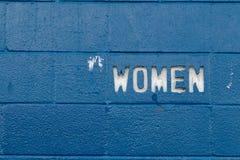 White woman text cut into blue concrete blocks royalty free stock photography