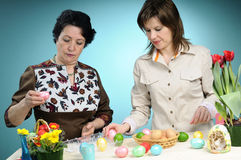 White women arranging easter eggs Royalty Free Stock Image