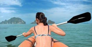 White women in orange kayak Royalty Free Stock Photos