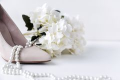White womens boat Shoe, pearl, necklace, flower, hydrangea, shoes. 1, white womens boat Shoe, pearl, necklace, flower, hydrangea, shoes stock image