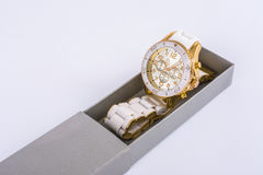 White women`s watches in the gray box royalty free stock photos