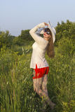 White women in sun hat  posture in field Stock Photography