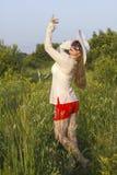 White women in sun hat  posture in field Stock Photo
