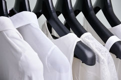White womens clothing hanging close up horizontal Stock Photo