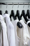 White womens clothing hanging side view vertical Royalty Free Stock Photography