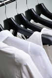 White womens clothing hanging vertical Royalty Free Stock Photography