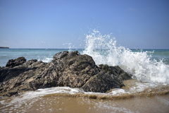 White won breaking on the stony shore in Cyprus. Waves of the sea, Extraordinary beaches, sea sand and large stones Stock Image