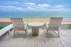 White wood beach chair near sea in summer. Royalty Free Stock Images