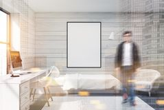White wood bedroom, computer and poster, man Stock Image